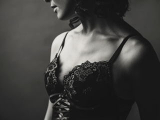 An example of a boudoir image from a bride intended to give to her groom as gift, by Loci Photography