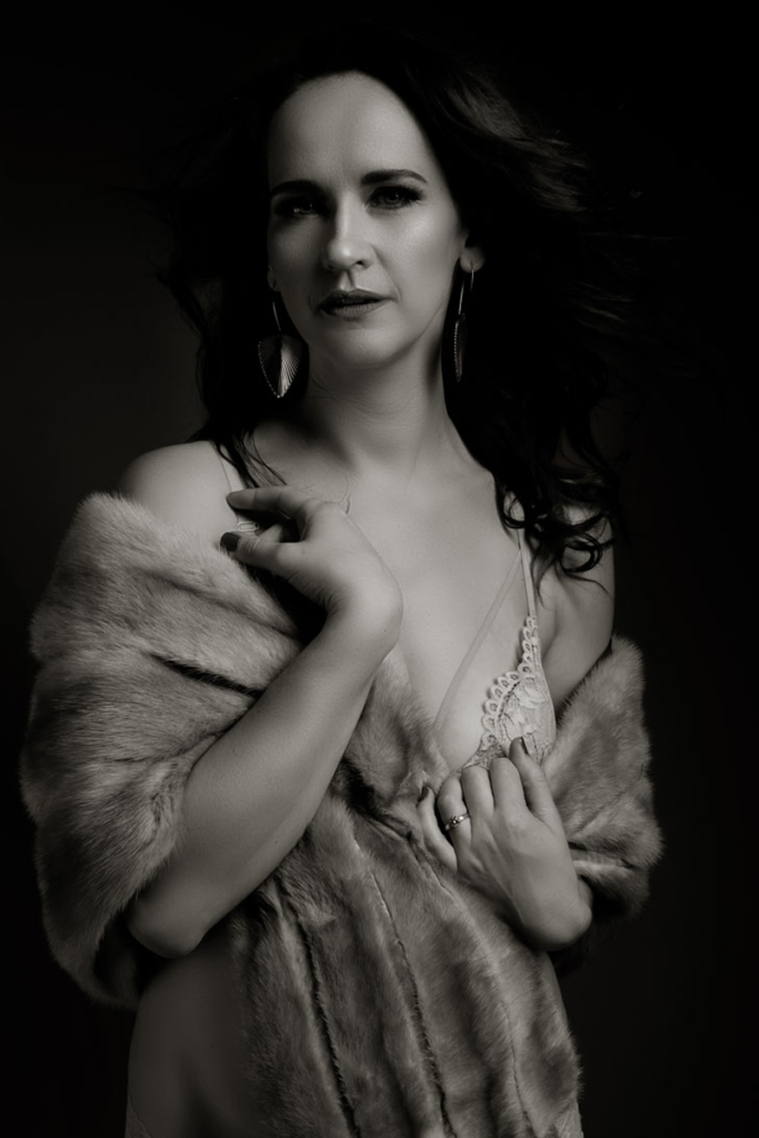 Stunning black and white boudoir shot of a classical boudoir image by Loci Photography