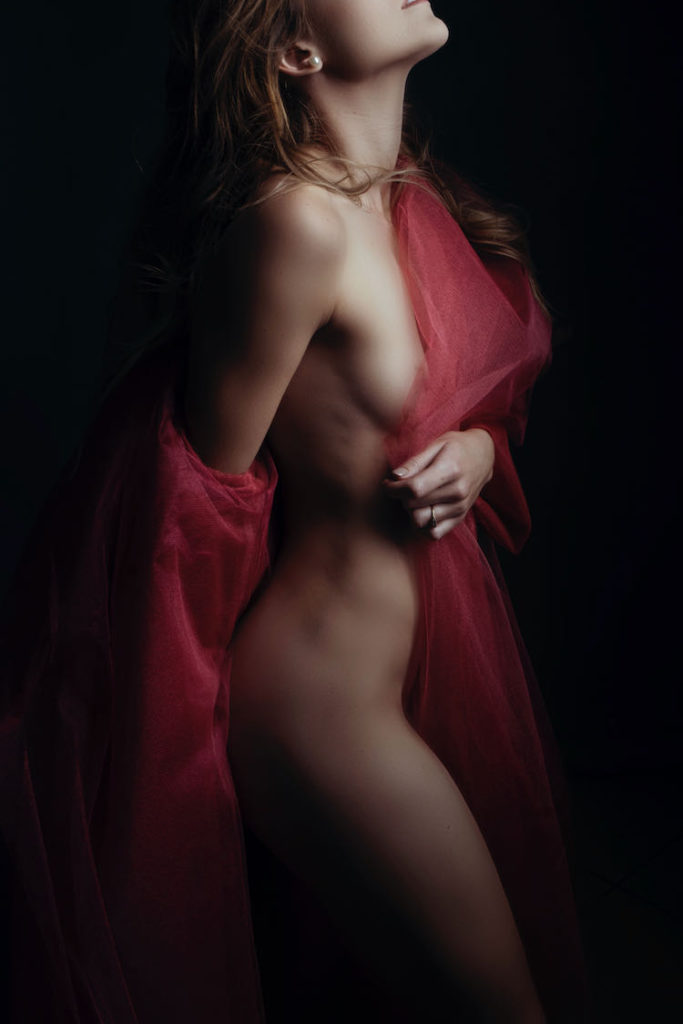 Stunning boudoir images done in the Loci Photography studio using the Nicolassi watermelon tulle coat.
