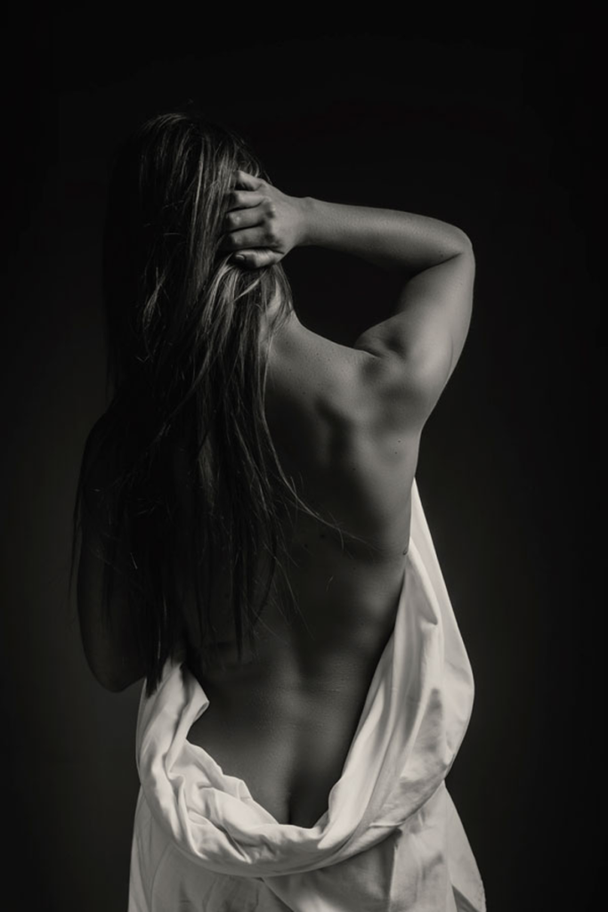 The gorgeous back shot taken during a professional boudoir shoot done in studio by Loci Photography.