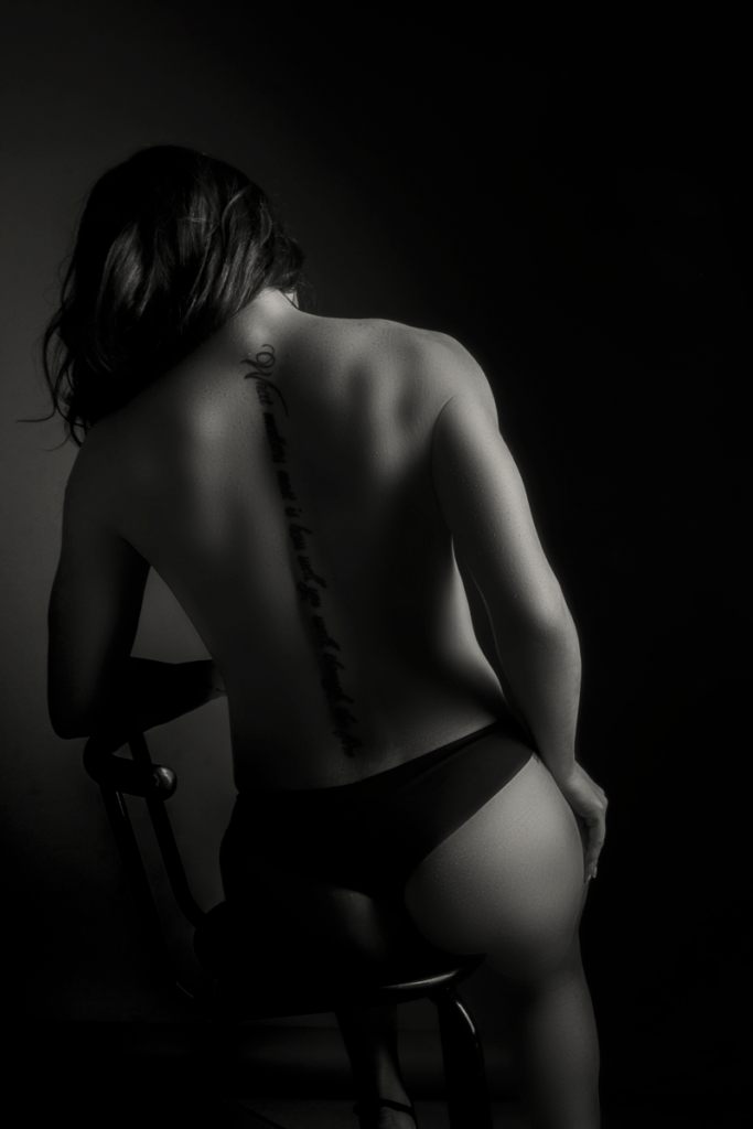 The back shot being a hero again during a boudoir shoot in studio by Loci Photography.