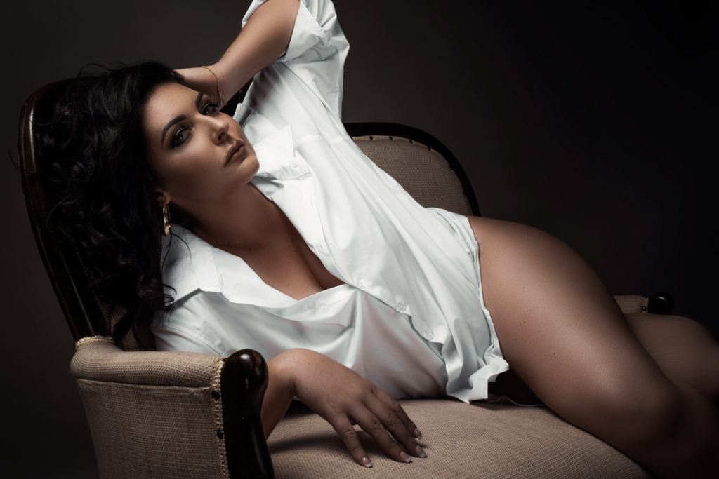 The utmost feminine experience during a boudoir shoot shot at the Loci Photography studio.