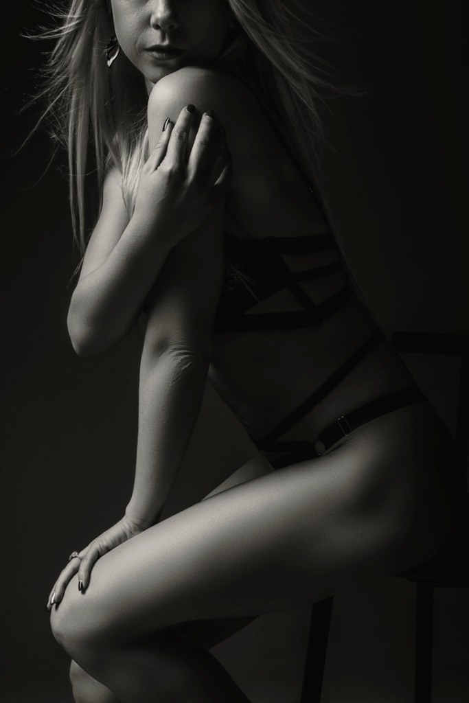The female lines being showcased sensually during a boudoir shoot done in studio by Loci Photography.