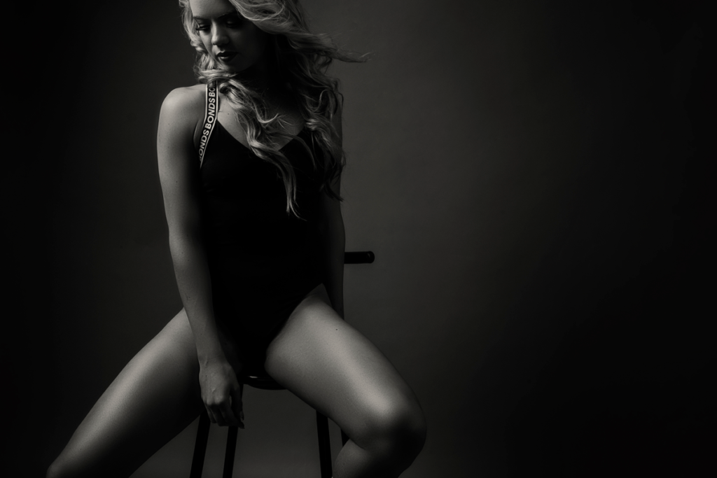Black and white moody fitness image taken in studio by Loci Photography.