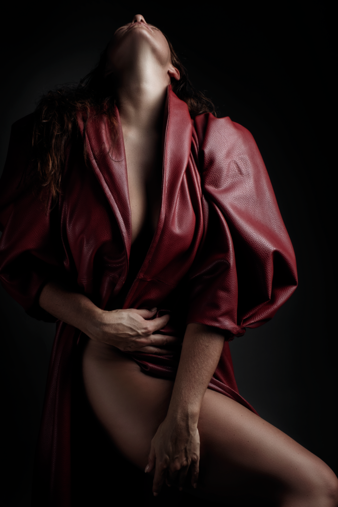 Using the Nicolassi redd coat in a gorgeous sensual pose during a Loci Photography boudoir shoot.