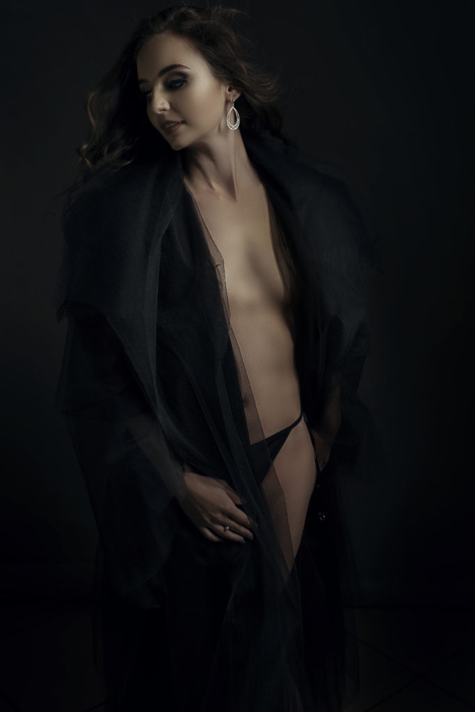 The stunning black Nicolassi tulle coat being used for a Loci Photography boudoir shoot.