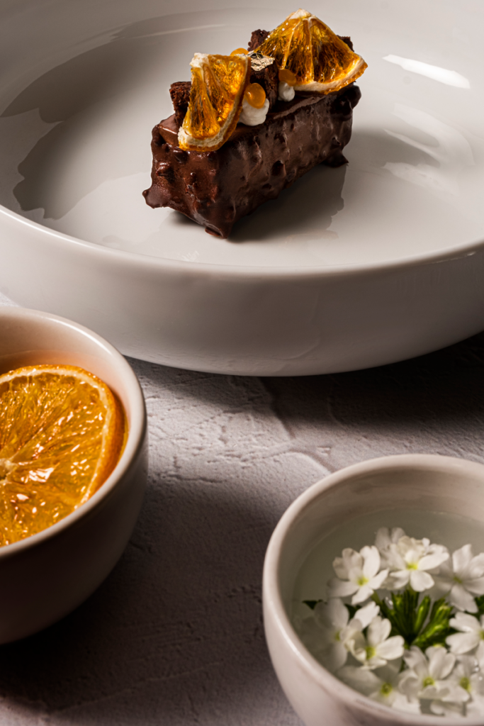 Doing styling together with a chef for a cookbook by Loci Photography