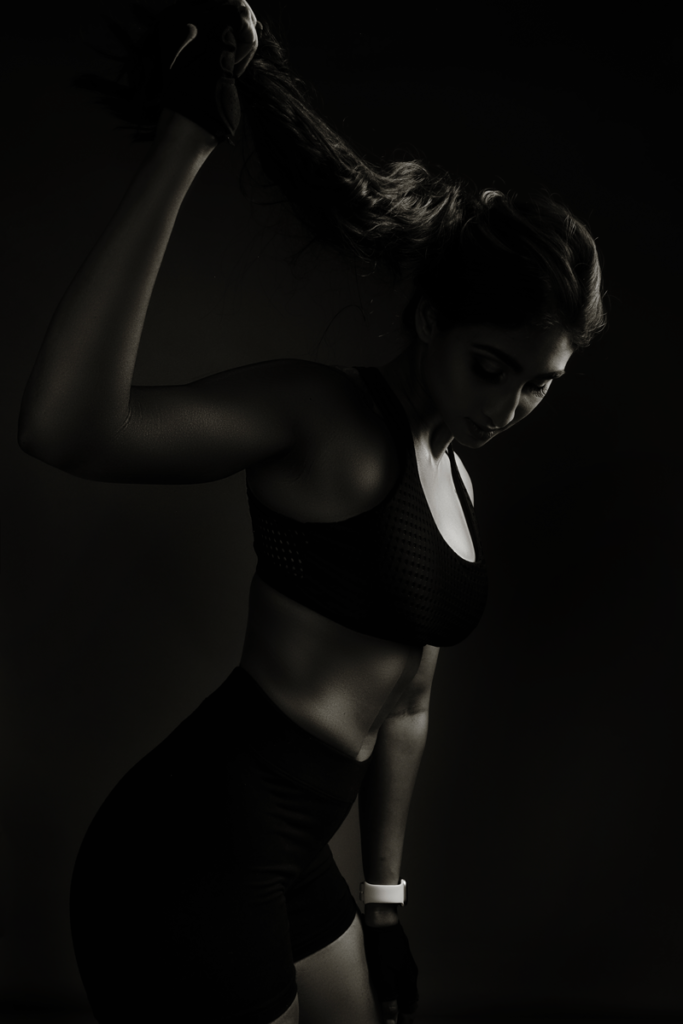 Showing off fitness physiques in studio by Loci Photography.