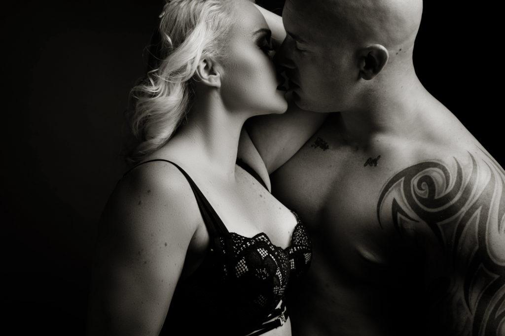 Black and white couple boudoir image taken in studio by photographer Yolandi Jacobsz of Loci Photography