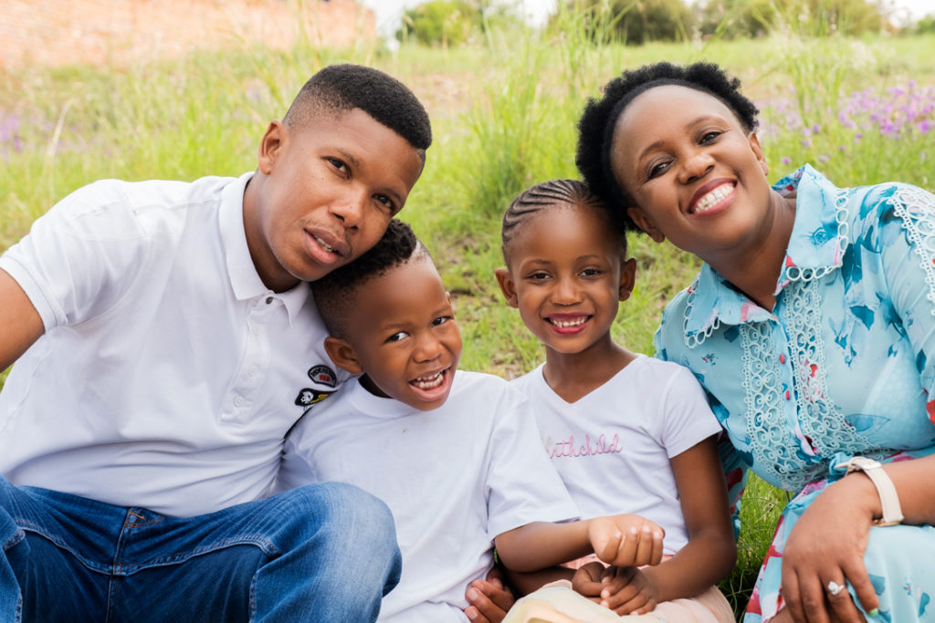 Image of smiling families during a family photoshoot in Hartbeespoort by Loci Photography