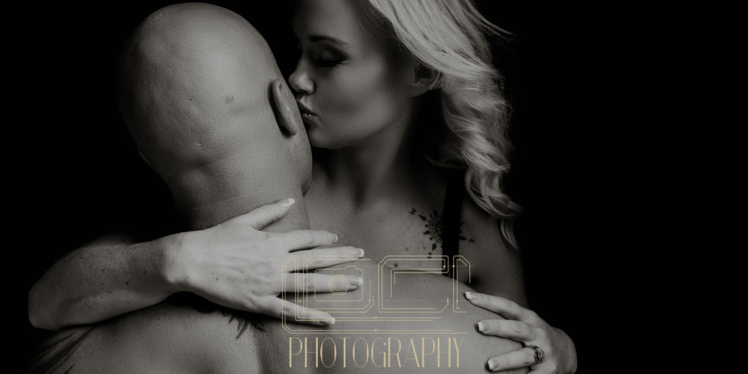 Black and white couple boudoir photography image done in studio by Loci Photography.