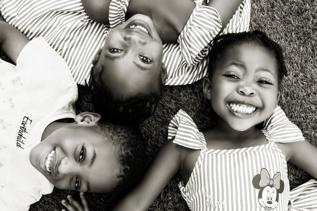 Smiling cousins during a family photoshoot done in Hartbeespoort by Loci Photography