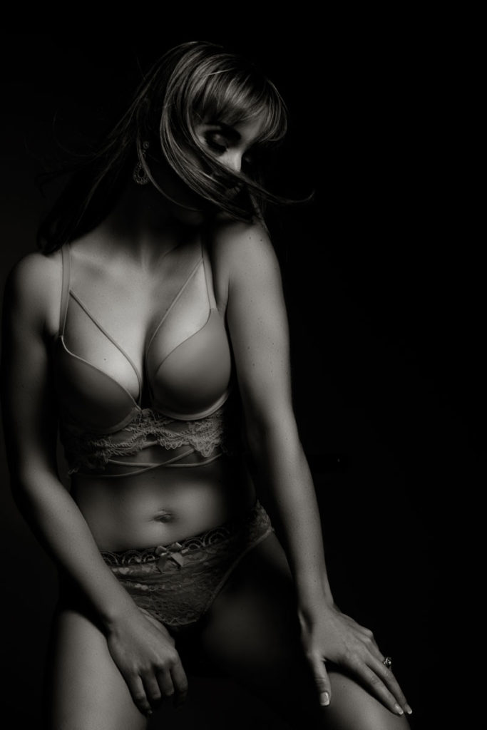 Black and white moody image taken in studio for a boudoir and lingerie shoot done by Pretoria photographer Yolandi Jacobsz of Loci Photography