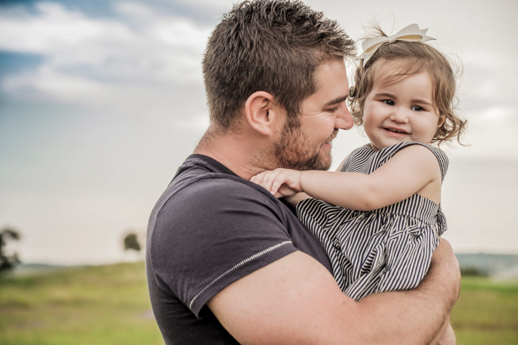 Image of daddy playing with baby during family photography done on location in Kempton Park by Pretoria photographer Yolandi Jacobsz of Loci Photography