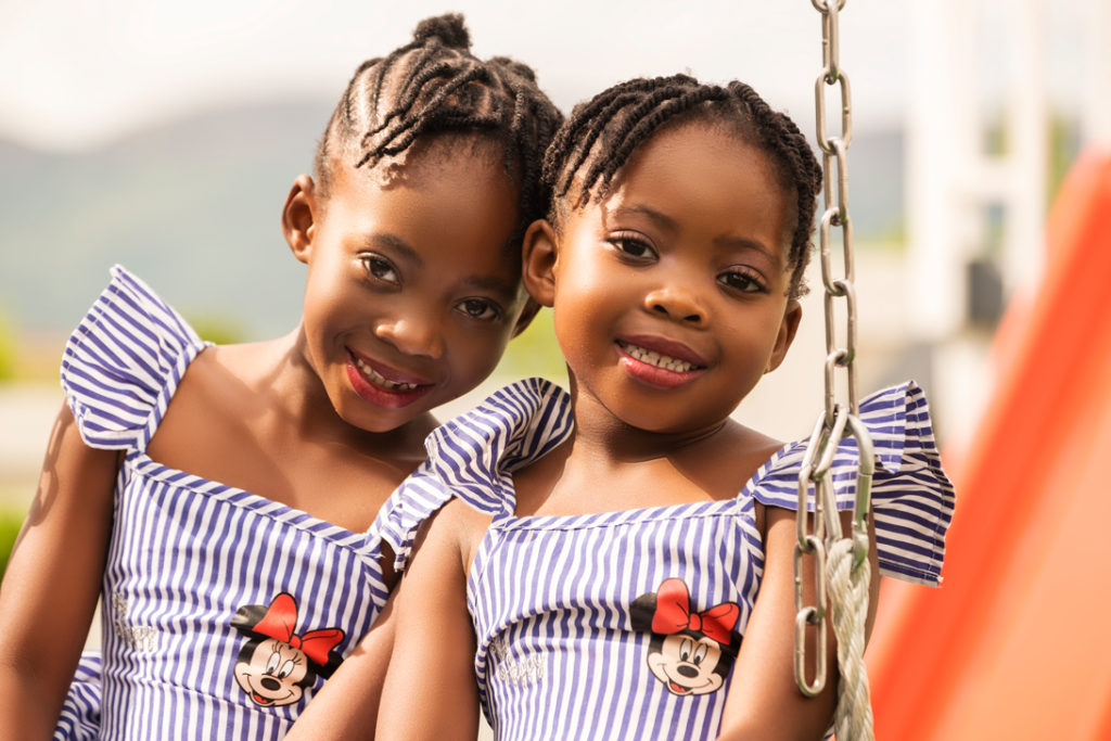 Smiling sisters during a family photoshoot done in Hartbeespoort by Loci Photography