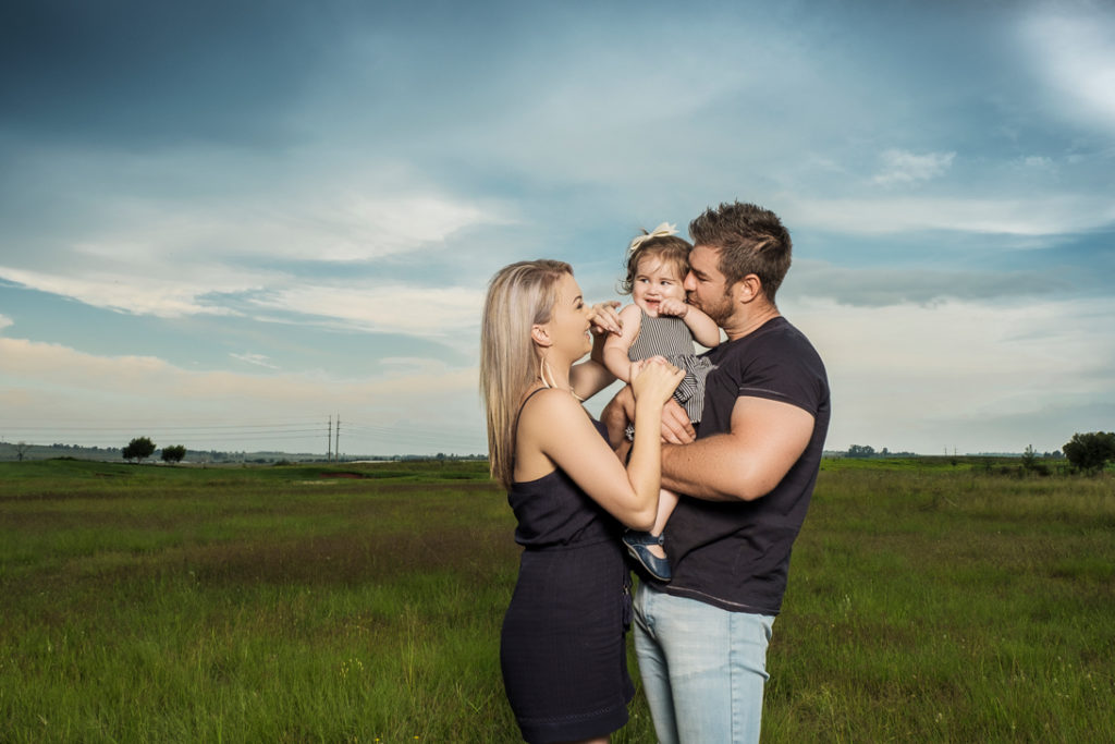 Image of young family during family photography done on location in Kempton Park by Pretoria photographer Yolandi Jacobsz of Loci Photography