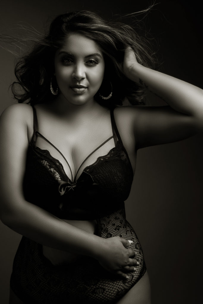 Black and white moody image taken in studio for a boudoir shoot done by Pretoria photographer Yolandi Jacobsz of Loci Photography