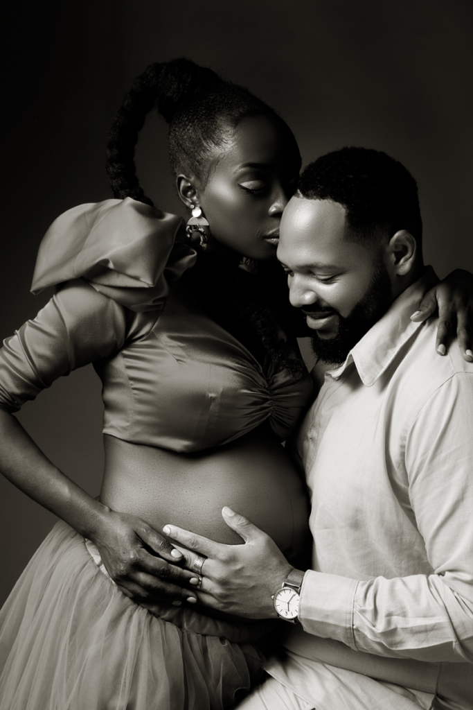 Black and white maternity portraits done in studio by Loci Photography.